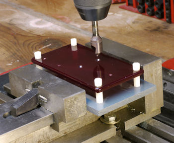 Machining lid while mounted to plate