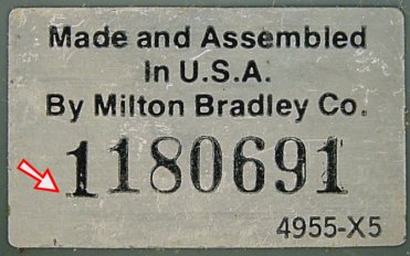 Big Trak silver-colored serial number sticker. The first '1' digit (see arrow) appears to be pre-printed.