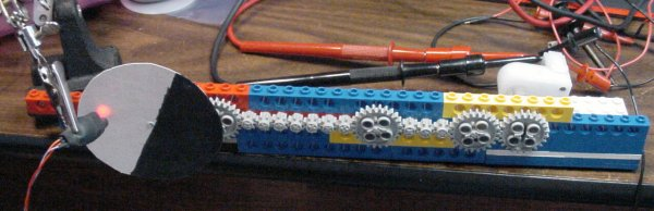 A chain of LEGO gears to simulate a loaded motor.