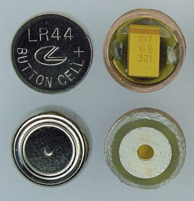 A capacitor and copper ring soldered to a PCB to substitute for an LR44 disposable button cell.