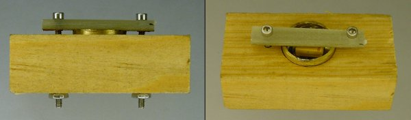A wood fixture with a PCB plank holds a difficult-to-solder workpiece in place.
