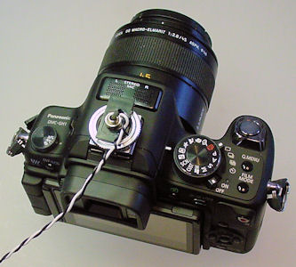 Camera with flash hot shoe connector attached