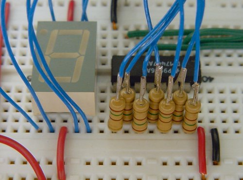 Inline resistors save space on a solderless breadboard.