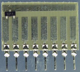 Surface mount transistor on a 6008 Surfboard.