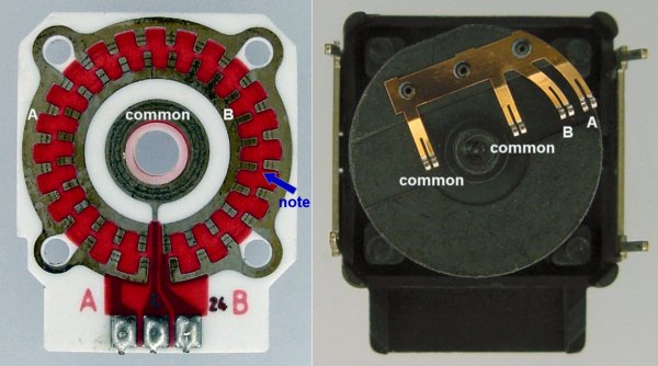 Inside a mechanical rotary encoder showing the PCB and brushes.