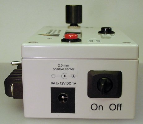 Side view of the BroMatic 2000 electronic counter showing the power plug receptacle and power switch.