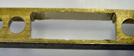 Brass face plate with unfinished slot.