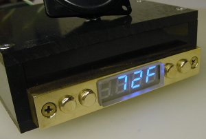 Solid brass display head with four-digit numeric blue LEDs.