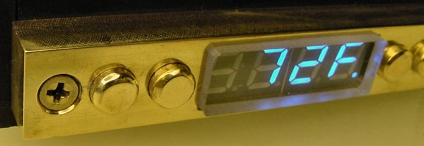 Electronic controls faced with a fancy solid brass plate with solid brass buttons.