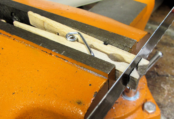 Sawing off tips of clothespin