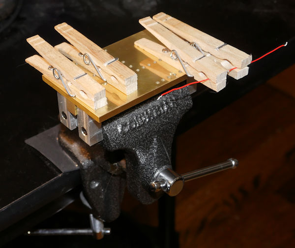 Wire soldering fixture made of clothes pins