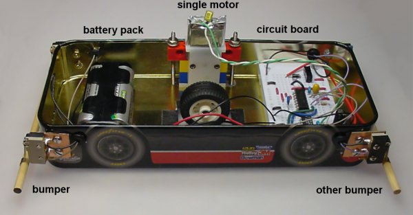 Side view of Flip-flop robot showing bumpers, battery pack, motor, and circuitry.