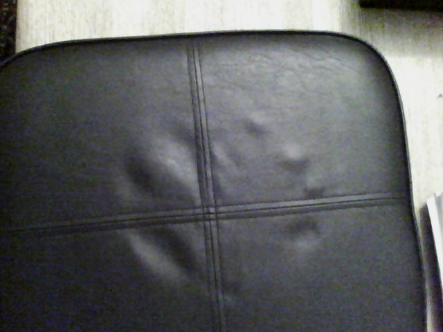 Hand print on cushion visible