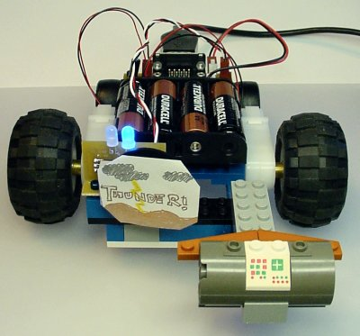 A simple joystick-controlled robot with a front-mounted power switch target (labeled Thunder!)