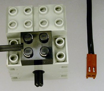 Lego motor with cable modified with a Molex KK connector to fit 0.1 headers.