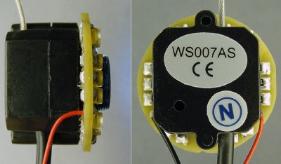 A side view and rear view of a surface-mount LED miniature ring light attached to a wireless video camera.