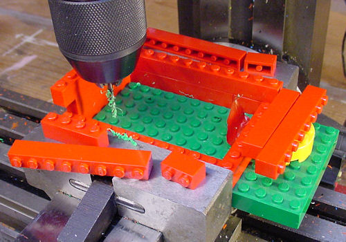 Drilling holes in Lego base with 4 40 drill to thread and attach circuit board