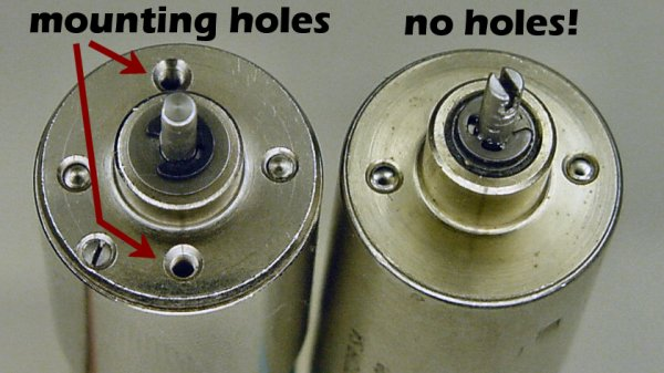 Two similar miniature electric motors. The motor on the right doesn't have any mounting holes.