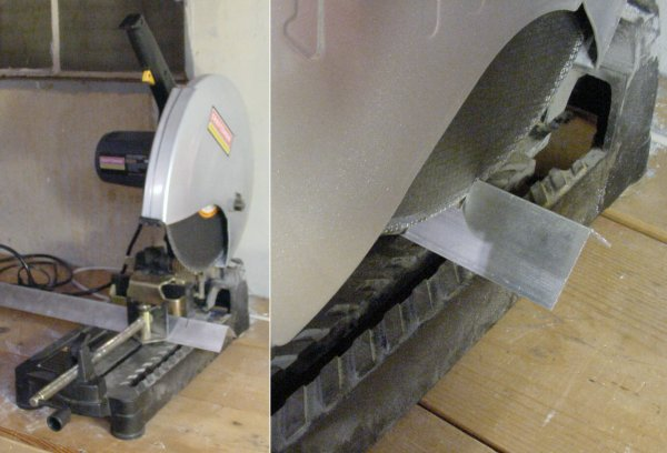 A chop saw with a metal cutting disc cuts through aluminum angle stock.