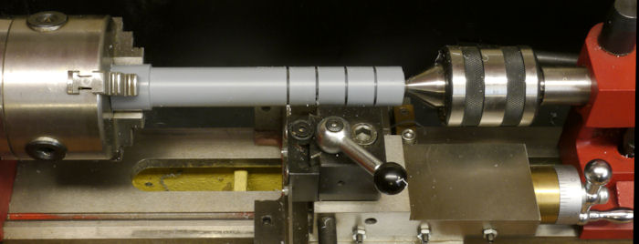Partitioning rod using cut off tool on a lathe