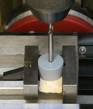 Step 1: Align drill bit using cylinder with lathe centered hole