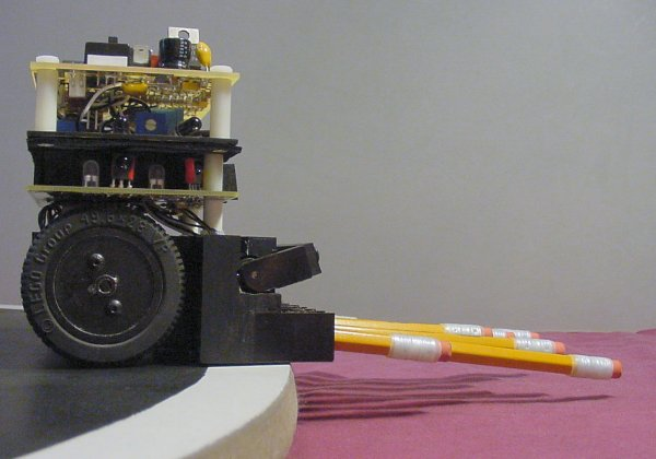 A rod holds up the offensive weapons of a mini-sumo robot, so that it won't be disqualified for touching the ground.