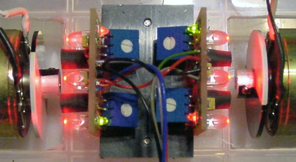 A closer look at a pair of back-to-back encoder boards with red LED emitters.
