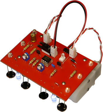 Open Face Sandwich robot with hidden elements designed to focus attention on the red PCB