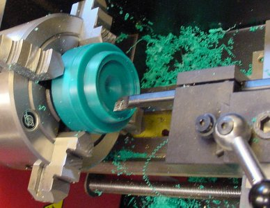 Boring bar on a lathe removes material from the center of the workpiece.