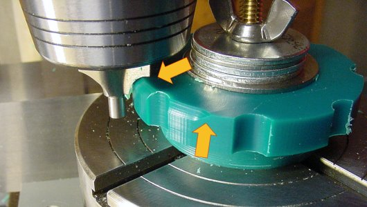 Rounding off sharp edges by using a curved router bit on a milling machine.