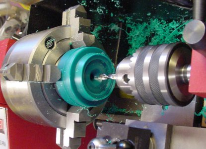 Drilling the center of the workpiece on a lathe.