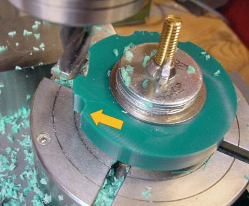 Cutting grip holes around the workpiece perimeter on a rotary table on a milling machine.