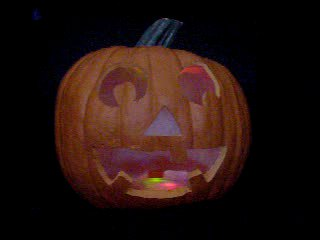 Click to see a movie of a pumpkin with red, green, and blue flashing LEDs.