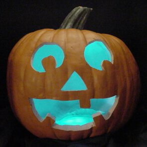 Pumpkin lit with aqua LEDs instead of a candle.