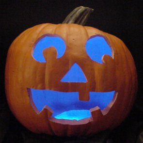 Pumpkin lit with blue LEDs instead of a candle.