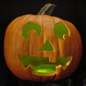 Pumpkin lit with green LEDs instead of a candle.