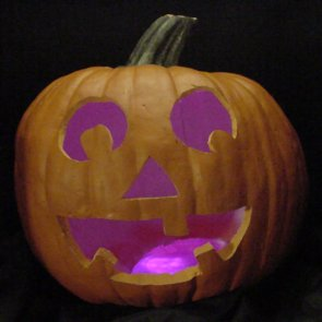 Pumpkin lit with pink LEDs instead of a candle.