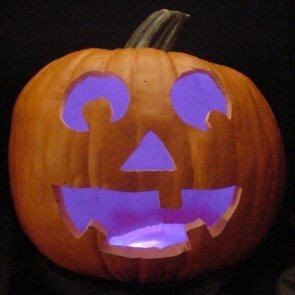 Pumpkin lit with purple LEDs instead of a candle.