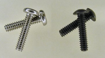 Stainless-steel pan-head slotted machine screws (left) versus black-oxide coated button-head socket cap screws (right).