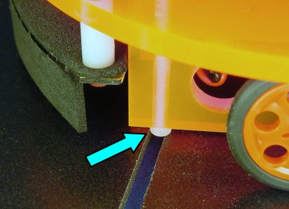 A standard socket cap screw head catches on the gap between the tiles in the ChiBots robot line-following course.