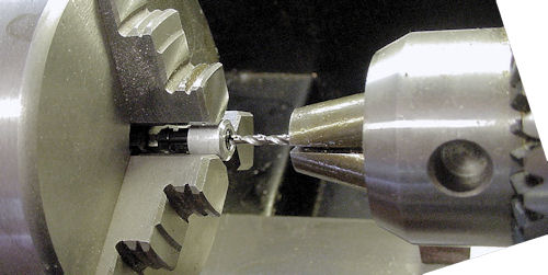 Drilling motor shaft hole with cross axle in place