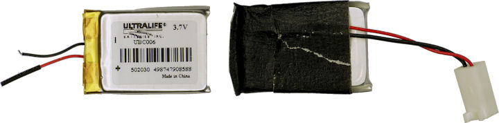 Small Ultralife lithium polymer battery wrapped in black masking tape for strain relief