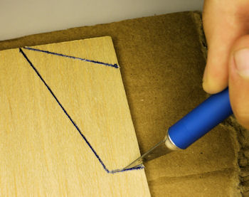 Cutting out fin from balsa wood by multiple passes of a hobby knife