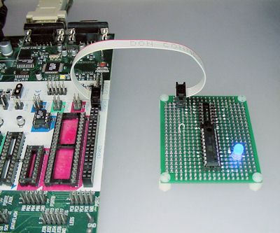 Homemade ATtiny861 and ATtiny84 adapter board (right) via ISP ribbon cable to the Atmel STK500 programmer (left).