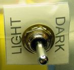 Light, off, dark line-following toggle switch