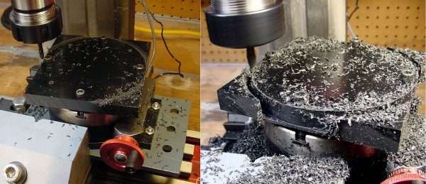 A milling machine cuts out a disc from a black plastic plate on a rotary table.