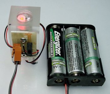 A laser module in a plastic block with an external power switch and Energizer battery pack.