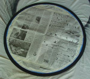 Newspaper masking middle of ring