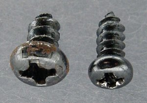 Two sizes of small, pan-head, phillips-drive, sheet-metal screws.