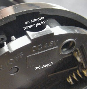 Redacted AC adapter power jack.